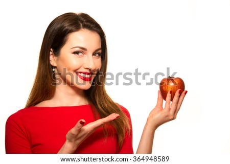 Positive Female Biting a Big Red Apple Fruit Smiling on White Pointing - stock photo