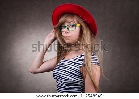 positive girl in red hat with eyeglasses - stock photo