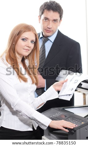 Positive girl with documents near copy machine