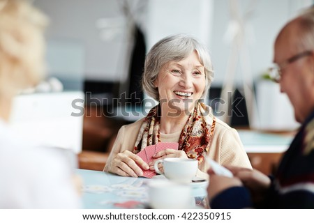 Positive granny with her friends - stock photo