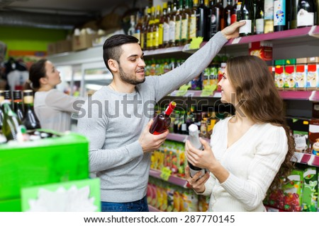 Positive happy customers buying beverages for dinner at food shop - stock photo