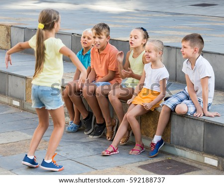 Positive Kids School Age Playing Charades Stock Photo ...