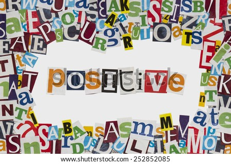 Positive letters cut from newspaper - stock photo