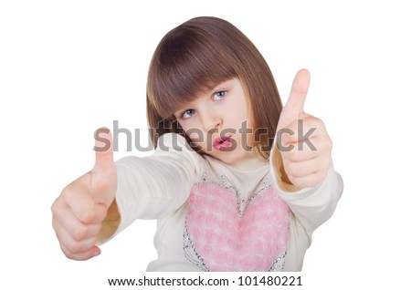 Positive little girl showing a thumbs up isolated on white background - stock photo