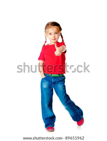 Positive little girle showing a thumbs up against white - stock photo
