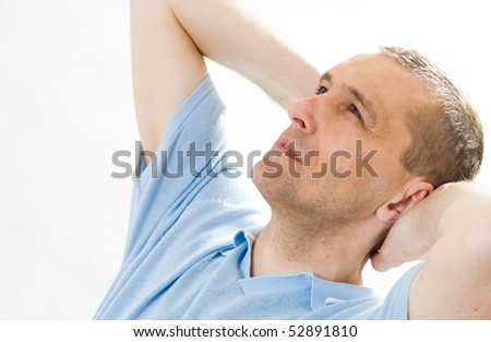 positive man in  shirt on a white