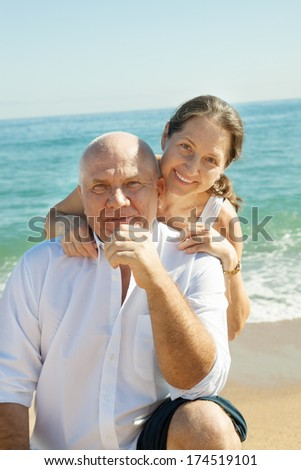 positive mature couple at sea vacation