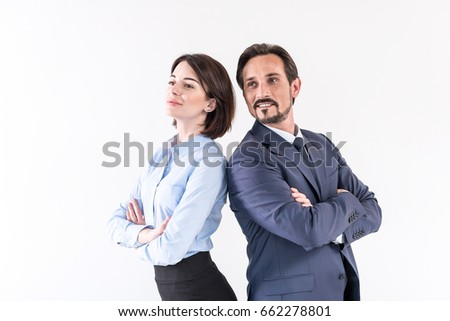 Positive mature man and young woman are posing together