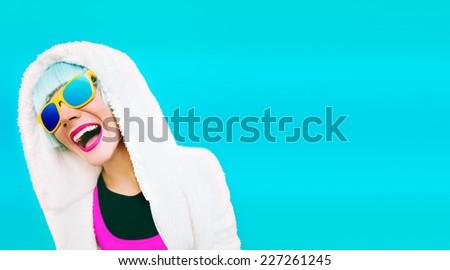 Positive model on bright blue background. Winter fashion Style - stock photo