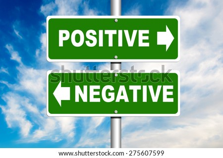 Positive Negative road sign. Crossroads with a blue sky in background - stock photo