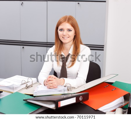 Positive office worker posing for camera