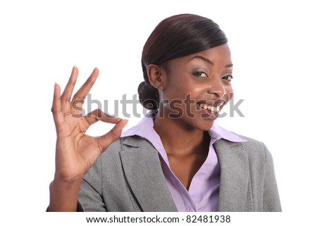 Positive okay hand sign by beautiful young ethnic african american business woman with a big happy smile. - stock photo