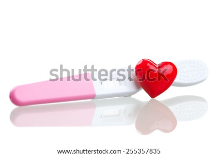 positive pregnancy test and a heart - stock photo