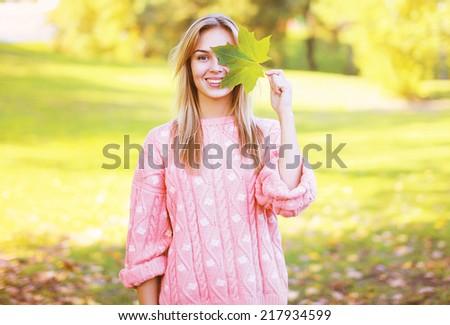 Positive pretty woman having fun in sunny autumn day - stock photo