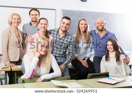 Positive professor and cheerful group of students at extension courses. Focus on girl