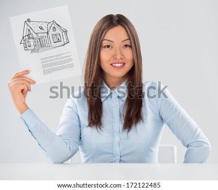 Positive realty agent or credit broker holding contract on new house. Mortgage concept - stock photo