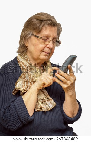 Positive senior woman in glasses dealing on the phone isolated over white background - stock photo