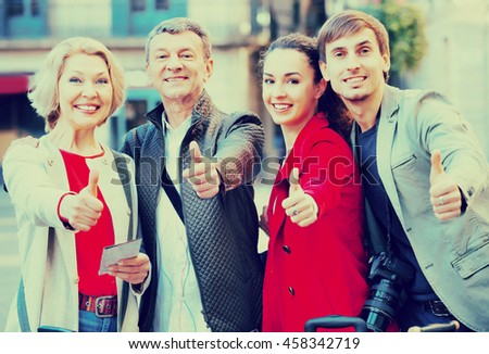 Positive  smiling family of four together in close up outdoor - stock photo