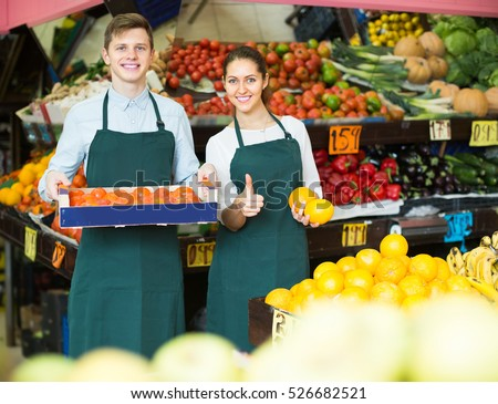 positive spanish stuff in apron selling sweet oranges, lemons and tangerines