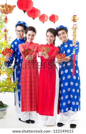 Positive Vietnamese congratulating with Tet �¢?? the traditional celebration of New Year - stock photo