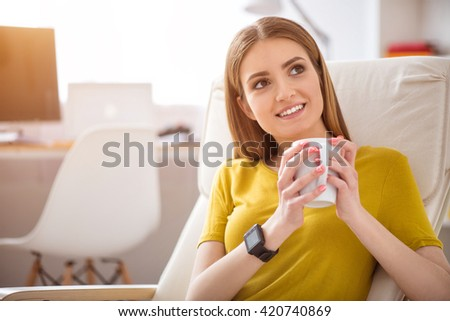 Positive woman drinking coffee