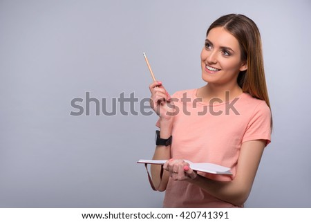 Positive woman holding notebook - stock photo