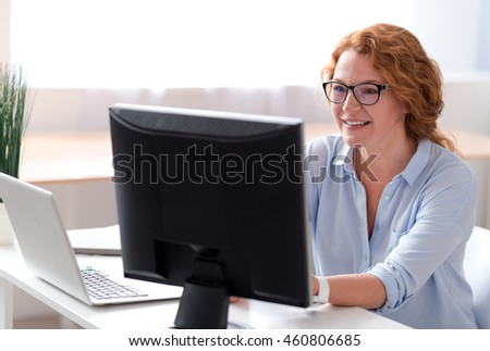 Positive woman using computer