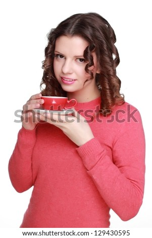 Positive woman with small cup of coffee
