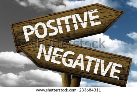 Positive x Negative creative sign with clouds as the background - stock photo