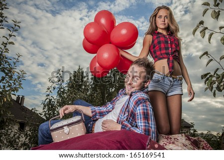 Positive young couple spending time outdoors. - stock photo