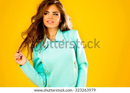 Positive young model girl,funny emotions,white teeth smiling woman,jacket outdoor.Fashion collection,trendy outfit,young lady,fashionable portrait,amazing hairs,lovely girl,long hairs,curly wavy  - stock photo