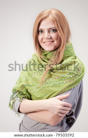 Positive young woman posing for camera in studio