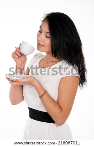 Positive young woman with cup of coffee on white background