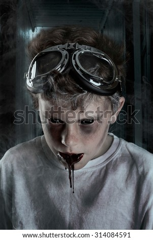 Possessed boy with black gunk coming out of his mouth - stock photo