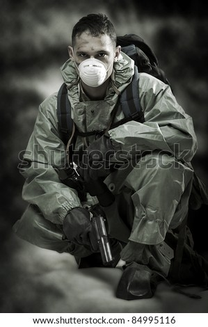 Post apocalypses world halloween concept. Portrait of man in gas mask - stock photo