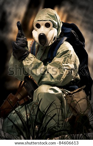 Post apocalypses world halloween concept. Portrait of man in gas mask. Protective military chemical warfare suit - stock photo
