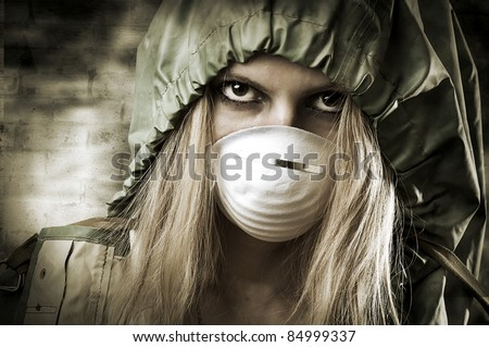 Post apocalypses world halloween concept. Portrait of young Sad woman in breathing mask - stock photo