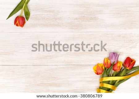 Post blog social media 8 march. View from above with copy space. Banner template layout mockup for woman day. White wooden table, top view on workplace. Lilac tulips at the Desk. - stock photo