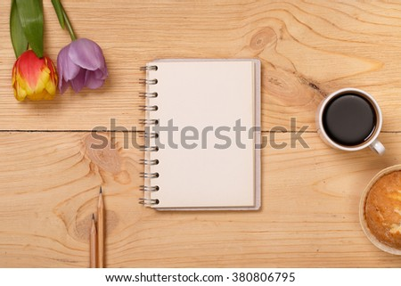 Post blog social media 8 march. View from above with copy space. Banner template layout mockup for woman day. Wooden table, top view on workplace. Lilac tulips at the Desk.