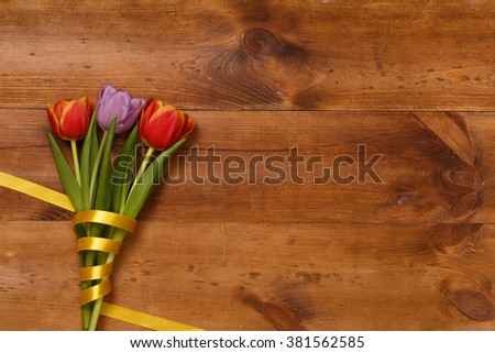 Post blog social media 8 march. View from above with copy space. Banner template layout mockup for woman day. Brown wooden table with tulips. festive bouquet for greeting card with place for text