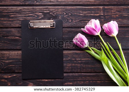 Post blog social media 8 march. View from above with copy space. Banner template layout mockup for woman day. Pink wooden table, top view on workplace. Lilac tulips at the Desk. - stock photo