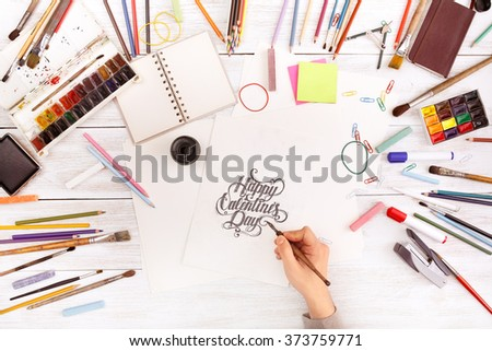 Post blog social media Valentines Day. View from above with copy space. Banner template layout mockup. White wooden table, top view on workplace. Desktop workplace designer, teamwork, painter top view - stock photo