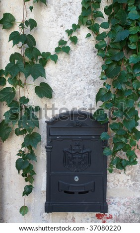 Post box on wall. Emblem Montenegro