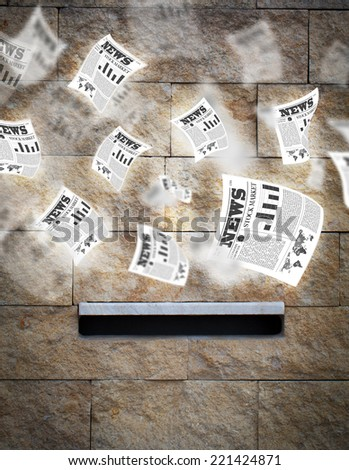 Post box with daily newspapers flying out - stock photo