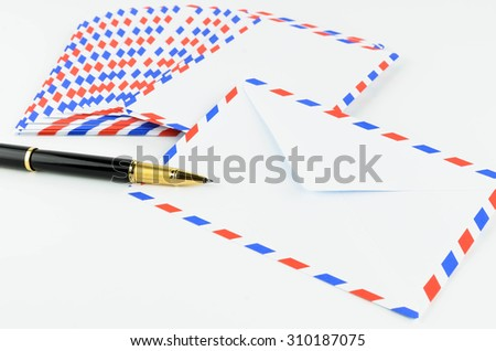 Post Envelope and Pen on White Background