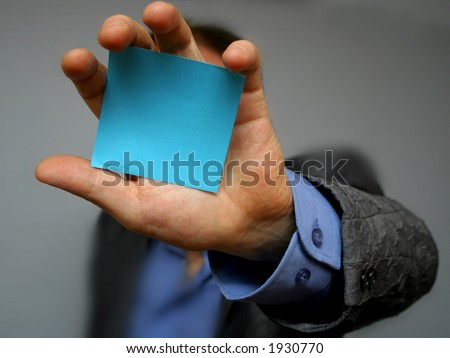 post-it in a hand - stock photo