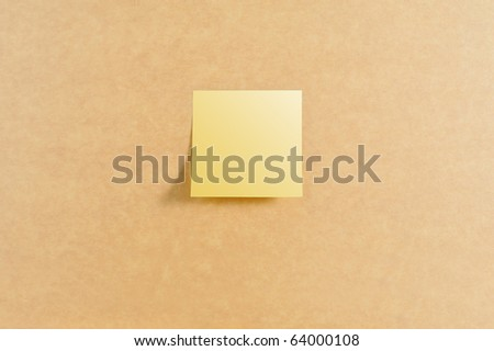 Post it in the center of brown board texture - stock photo