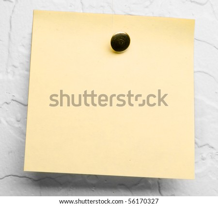 Post-it note on white textured wall - stock photo