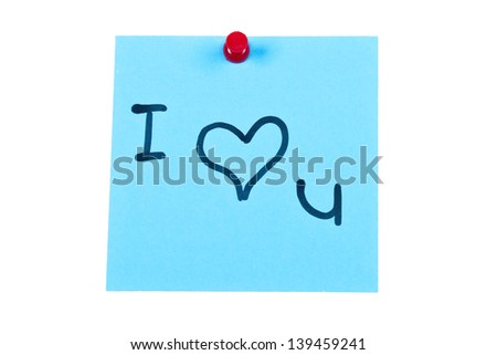Post it note on wood in blue with I love you - stock photo
