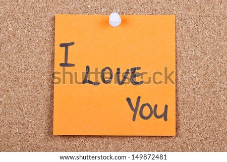 Post it note on wood in orange with I love you - stock photo